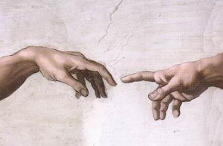 Picture of hands of God and Adam.